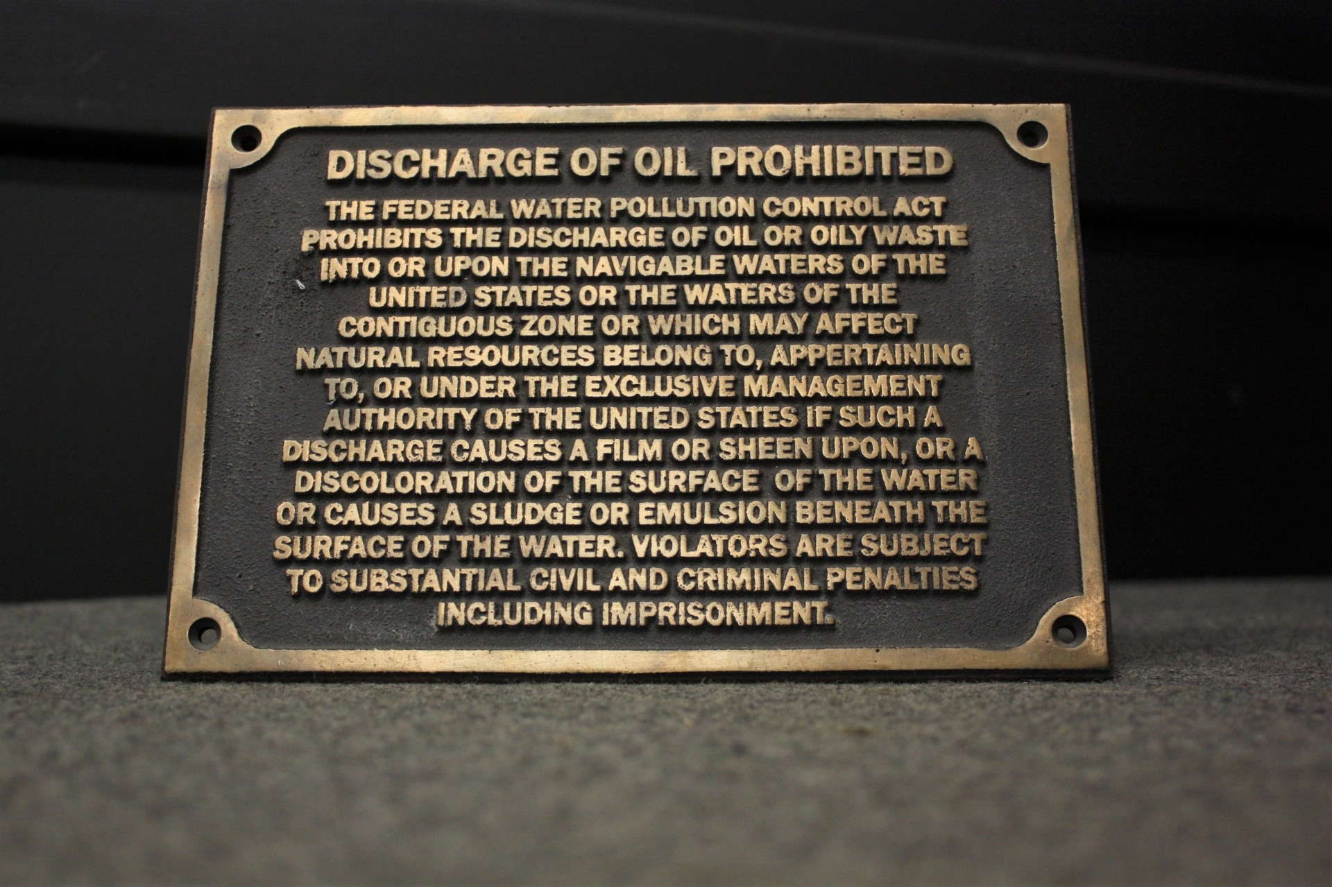 Bronze Discharge of Oil Plaque