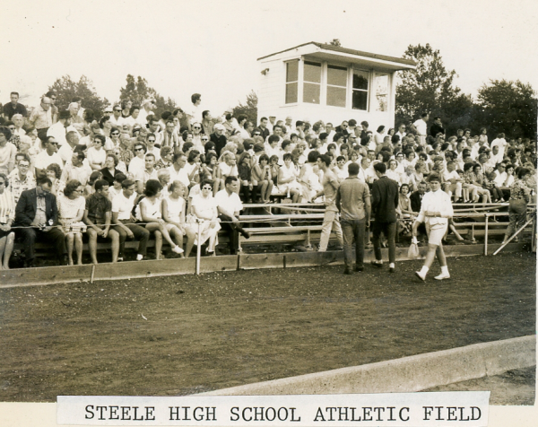 Fans on the bleachers at Memorial Field