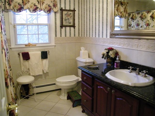 Gut job; all new Jacuzzi tub, toilet, vanity, sinks, tile, ceiling, crown moulding, chandelier, wallpaper, and more