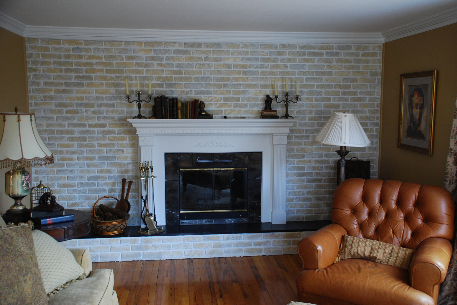 Custom designed mantel, faux painted bricks, crown moulding, and fireplace breastplate