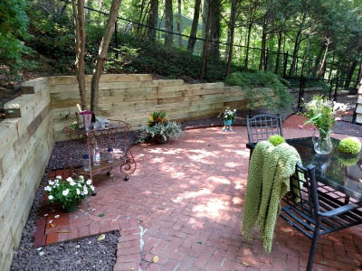 Removed rotted wall; constructed new wall 88' long