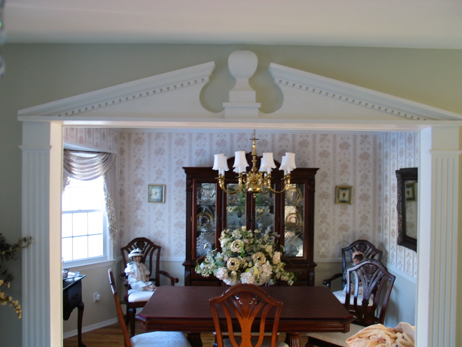 Install crown moulding, chair rail moulding, wallpaper, paint, and chandelier