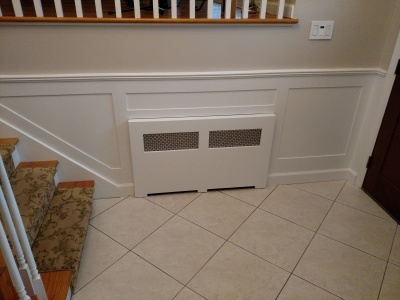 Update radiator cover, install wainscoting and chair rail moulding, paint.