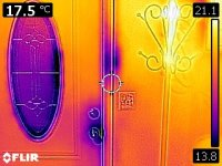 Infrared image of air infiltration around an exterior door.