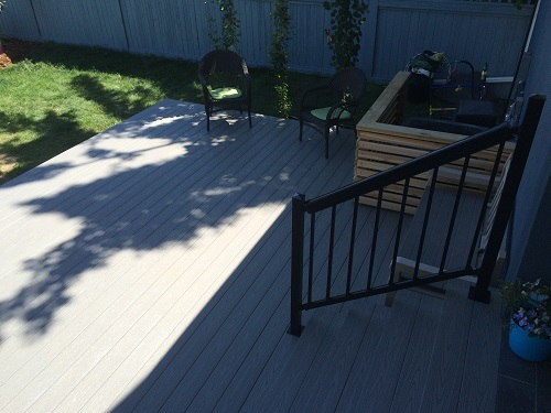 Composite deck and metal rail