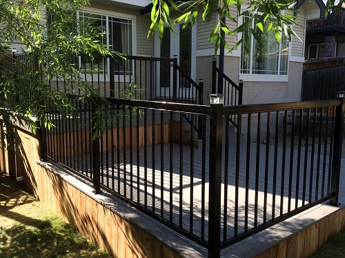 Black metal railing and composite decking