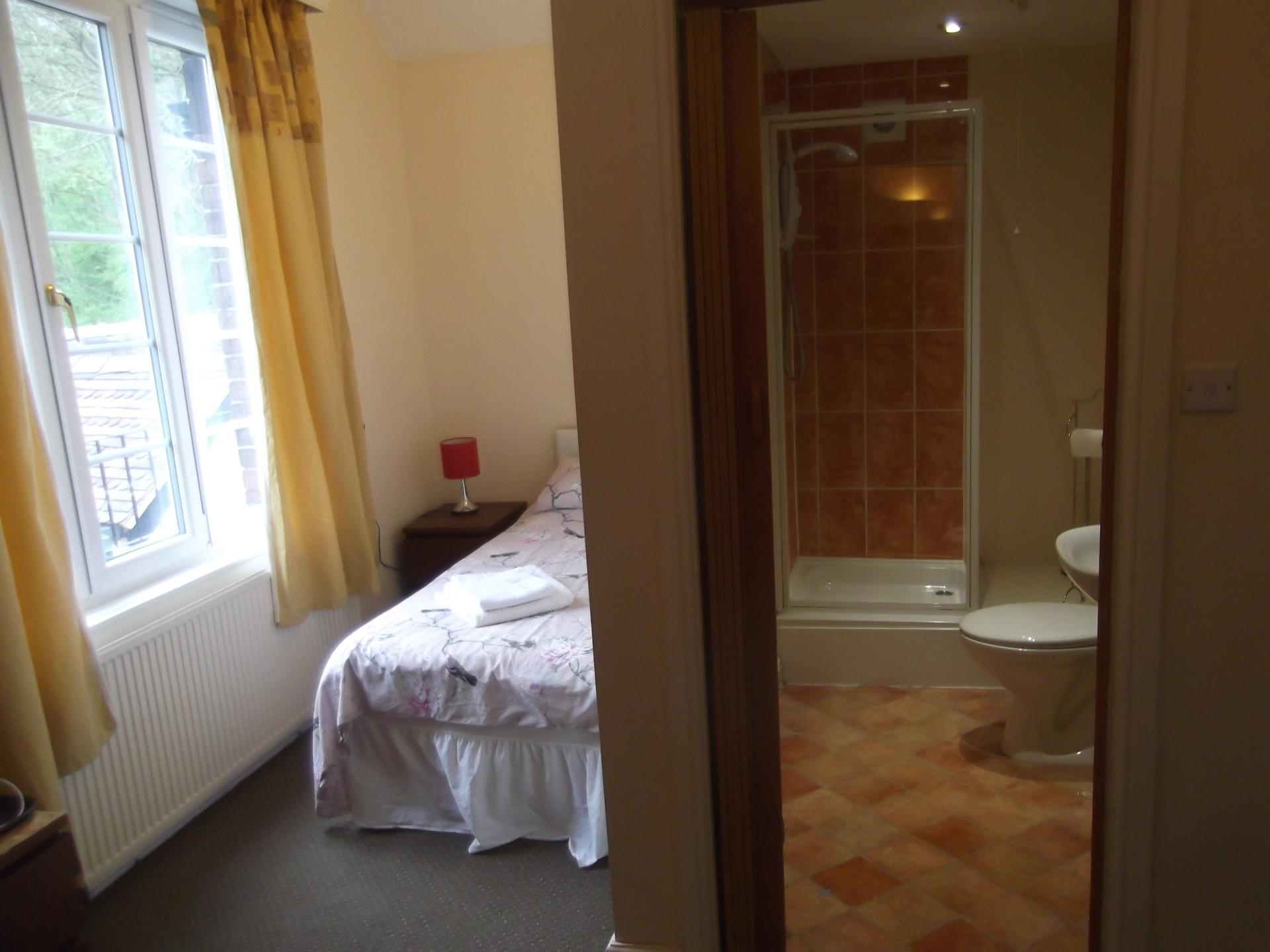 Bed with view of en-suite bathroom