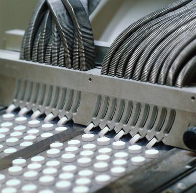 Machine manufacturing compliant pills.