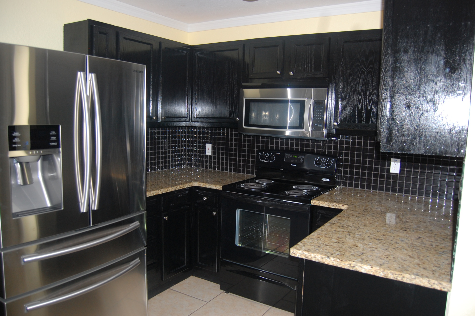 Pitch Black Sable Cabinetry with Stainless Steel