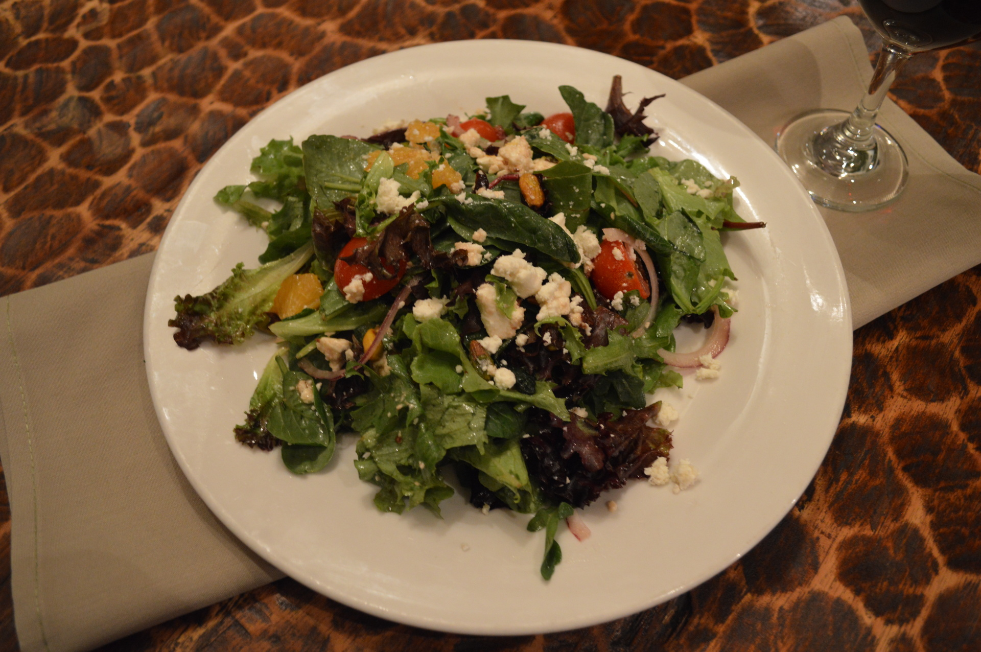 Mixed Greens with Grape Tomato, Orange Segments, Shaved Onions, Raisins, Pistachios and Feta Tossed with Dill Balsamic -Cilantro Vinaigrette  (GF)