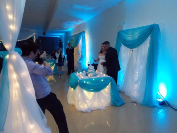 Blue Uplighting with Bride & Groom cutting the Cake