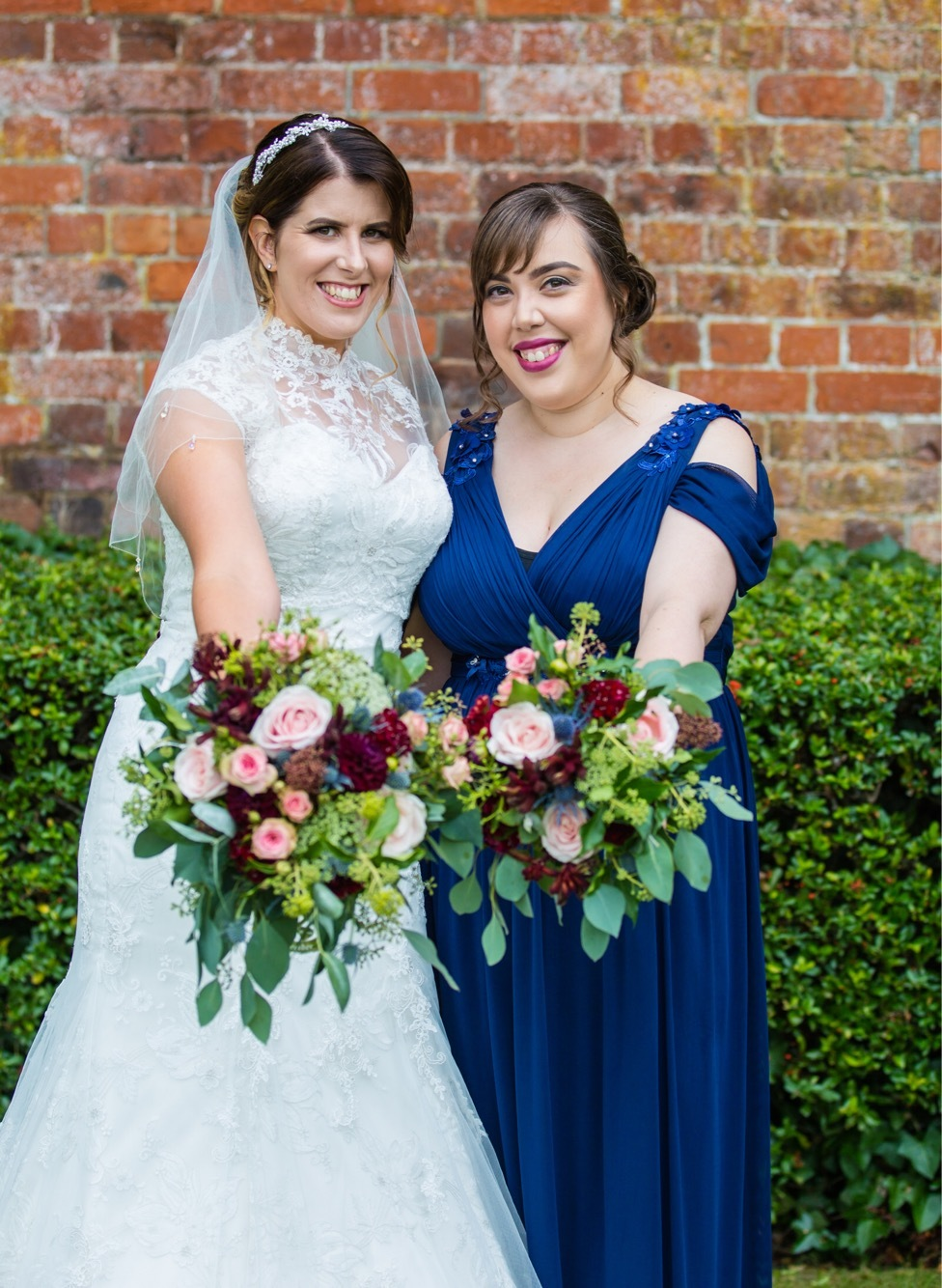 Anita and her Maid of Honour enjoying their flowers