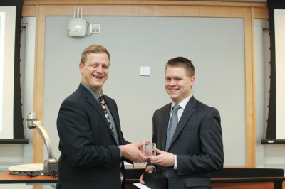 Professor Bortner presenting James Owens with his award from Rice University GCURS