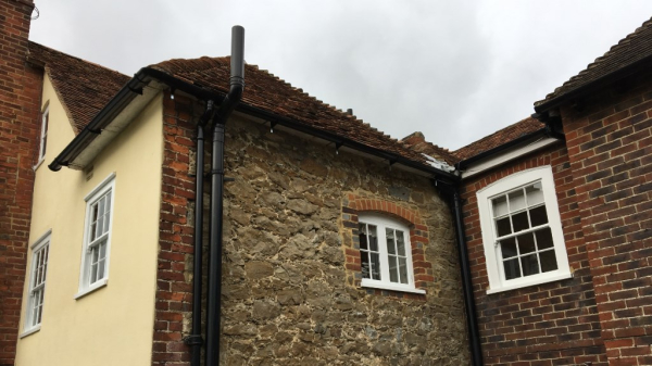 Black pvc gutter with rafter brackets