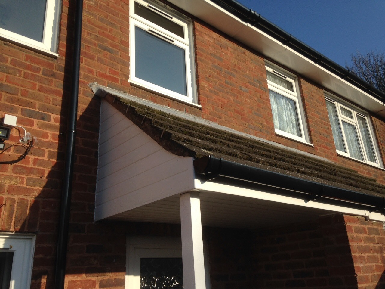 White upvc fascia with black deep flow guttering
