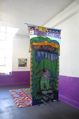 "Installation View: Decolonizing Education Banner for ""The Love in Our Belly"""