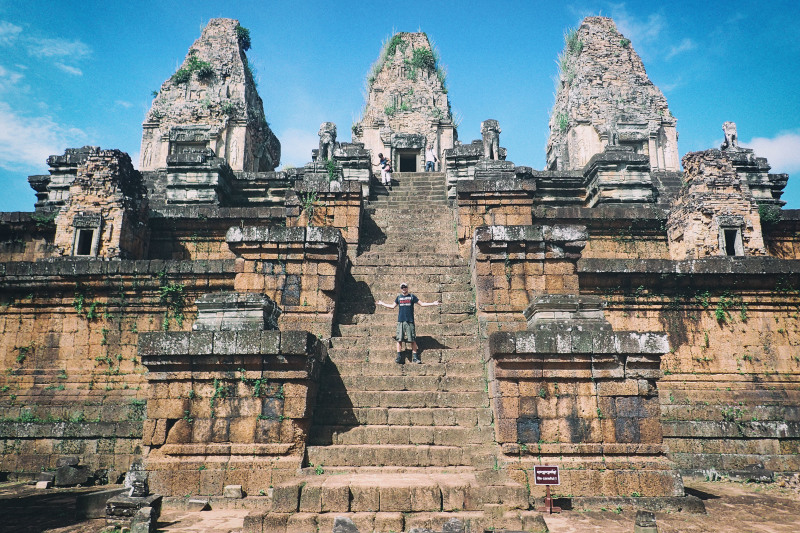 me standing half way up on a beautiful temple in cambodia