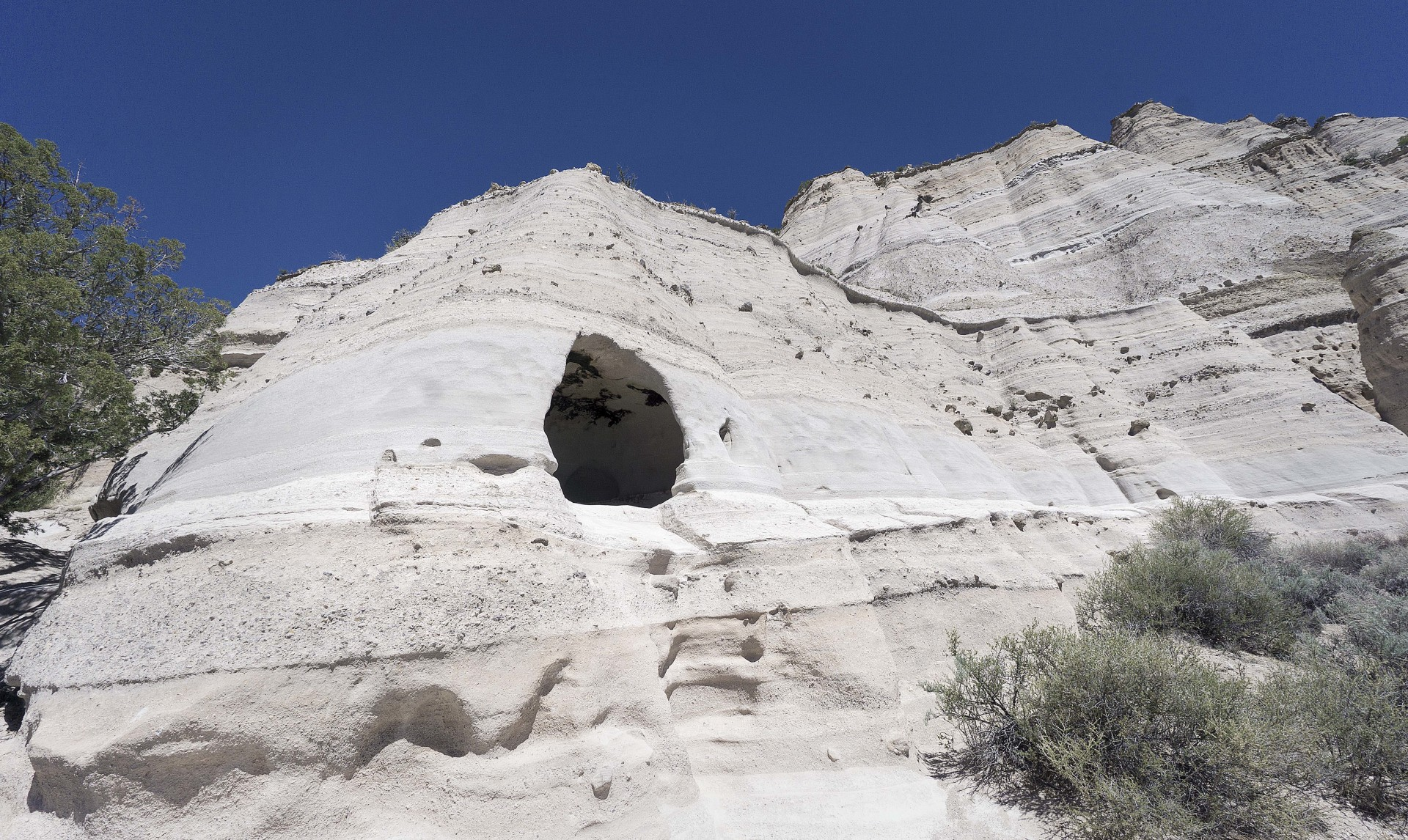 a cave in the side of the cliffs along the cave loop trail in the Kasha-Katuwe Tent Rocks National Monument