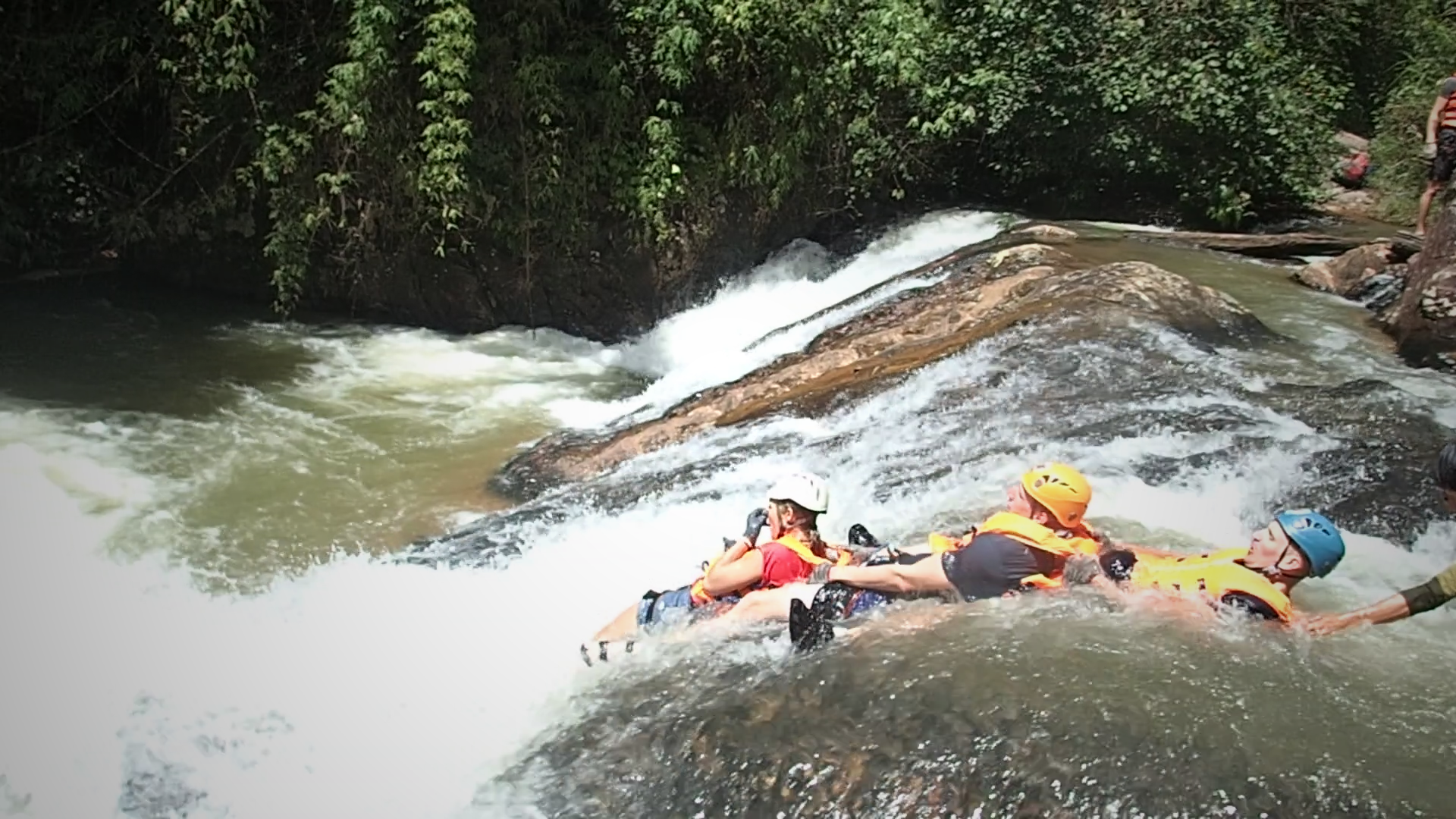 three of my fellow canyoning pals as we float over the natural water slide