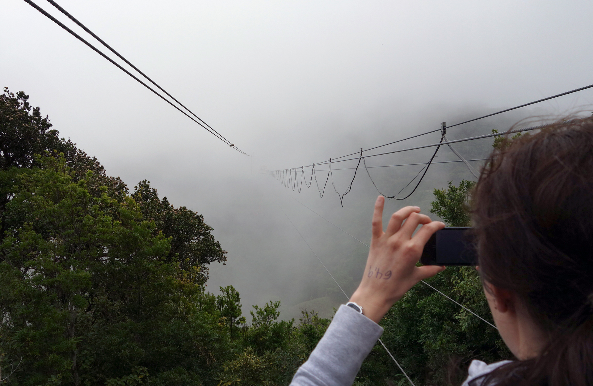 looking through the clouds while people bungee jump at monteverde's extremo