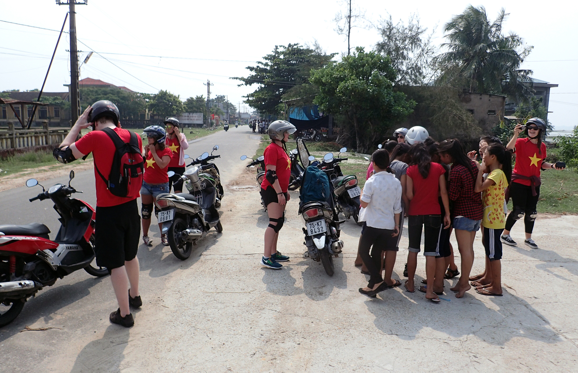 School kids running out to see us near a Vietnamese school