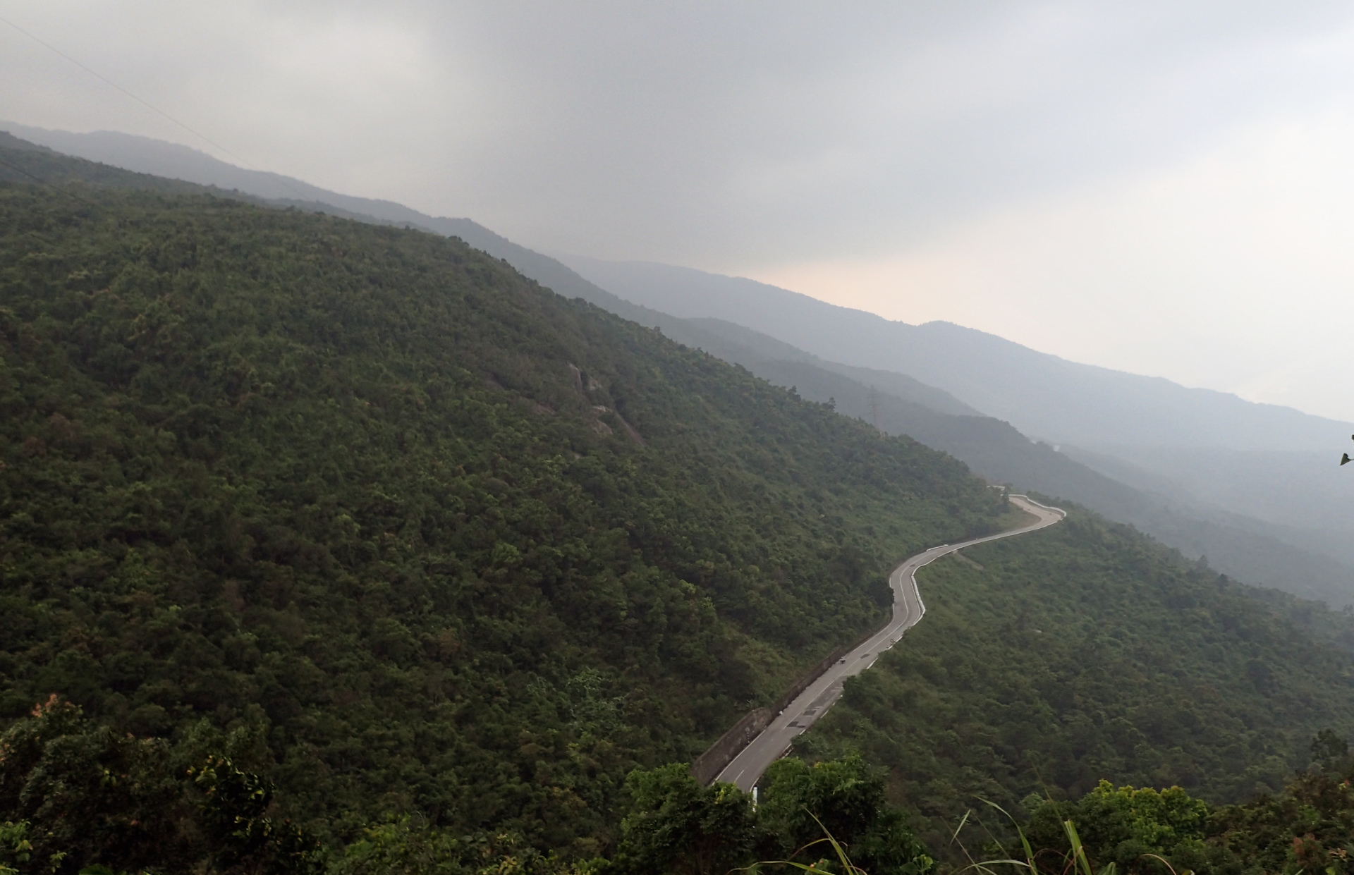 the winding road up hai van pass in the beautiful mountains of central vietnam