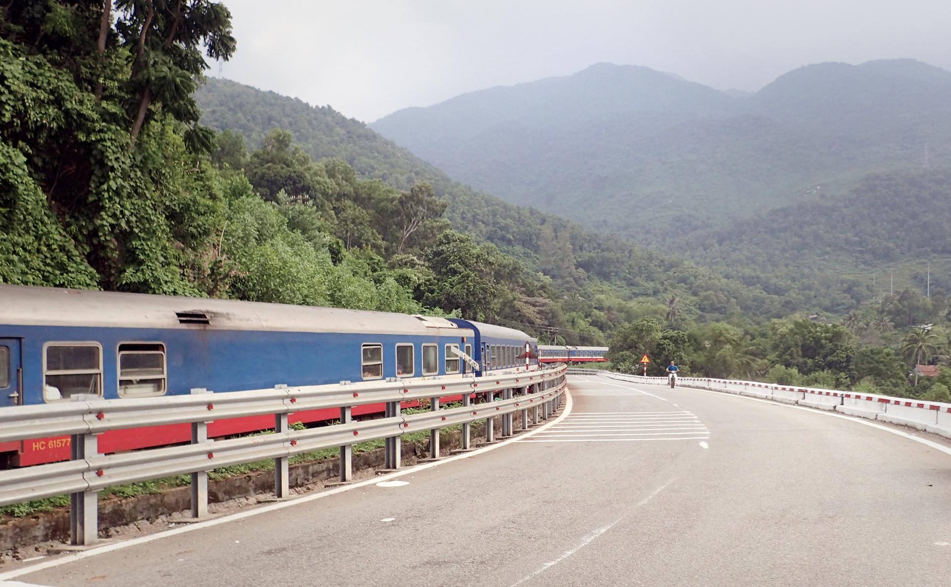 the mountains along a railway near the highways going up hai van pass