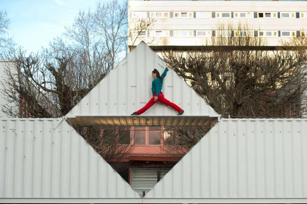 A Shipping Container Participates in the High Flying Act 'Origami'
