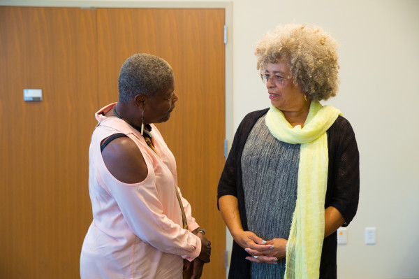 Angela Davis with a conference participant