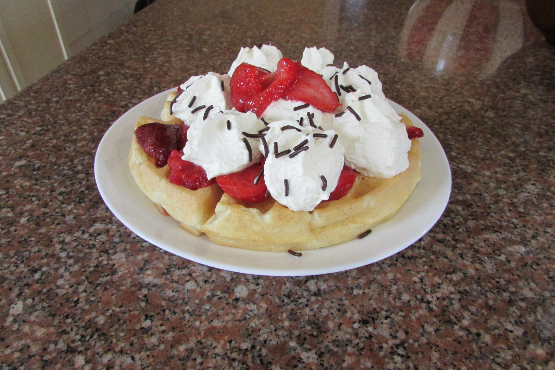 Strawberries blueberries raspberries waffles