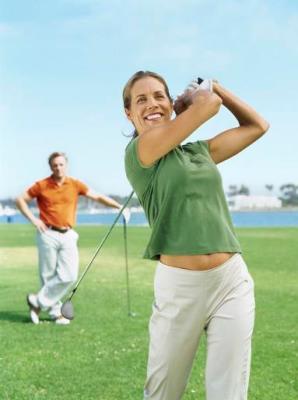 woman smiling while golfing