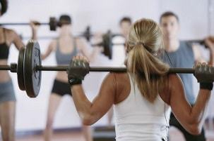 female weightlifter improving performance with deer antler velvet