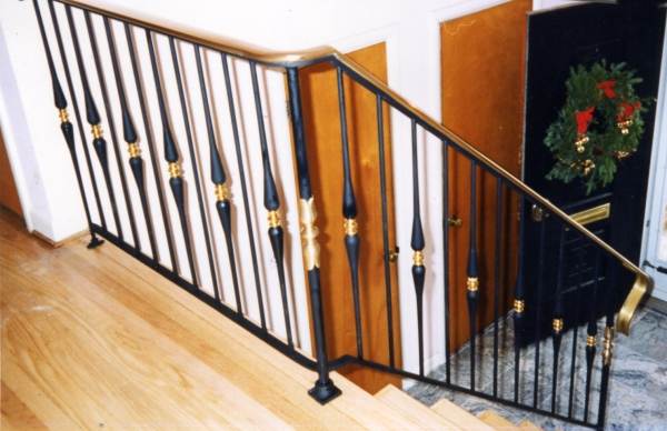 Black railings with gold trim look elegant