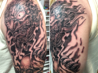 Mike Pfau Demon with Skull Tattoo
