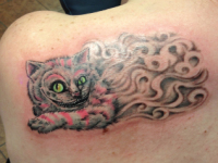 Mike Pfau cheshire cat Tattoo