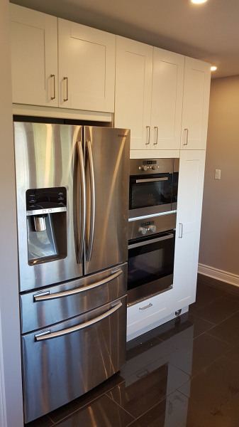 New Fridge location, stacked Oven & Microwave with broom closet and pull out racks