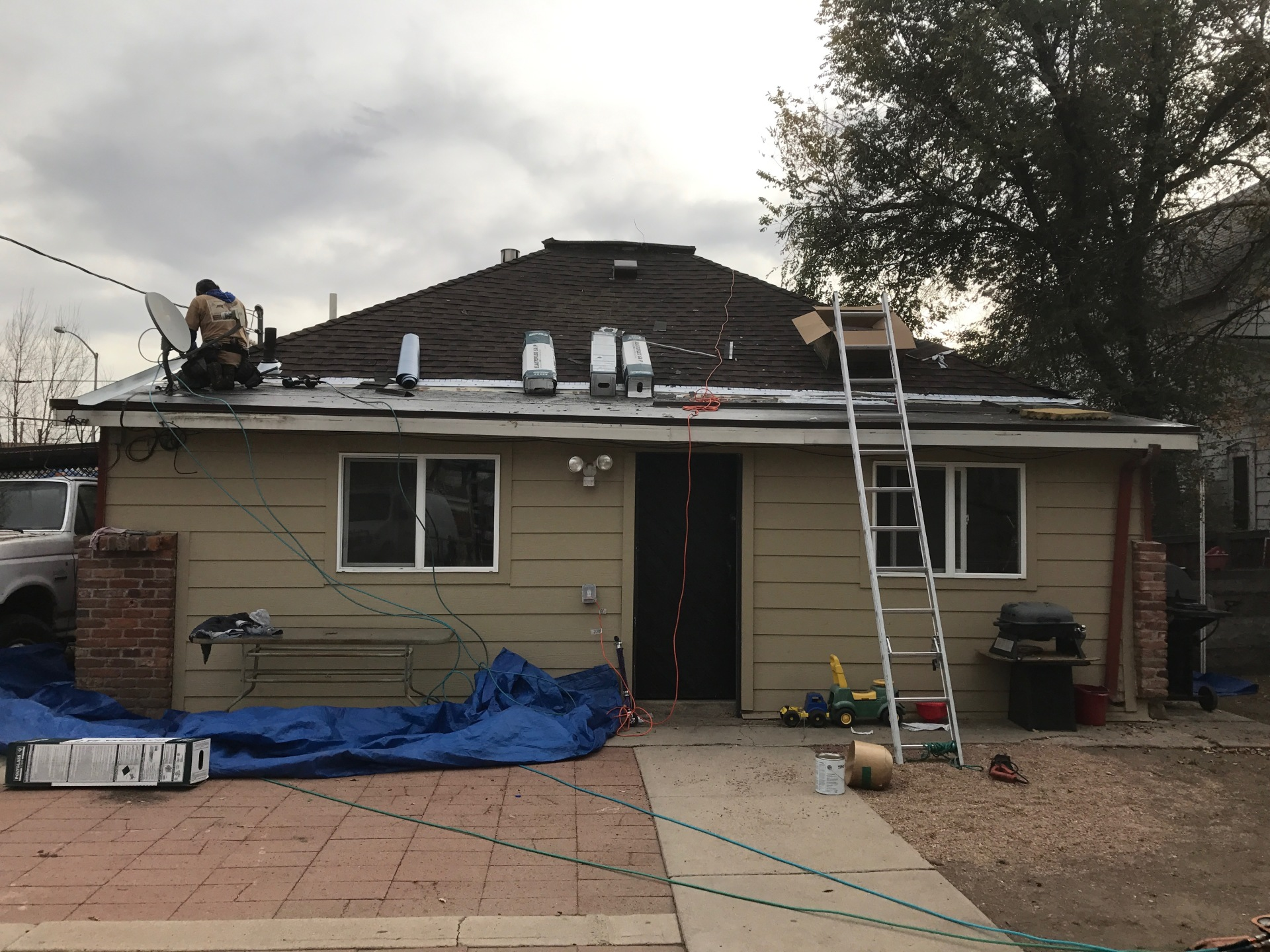 Installing roll roofing on the low slope of the back side of the house
