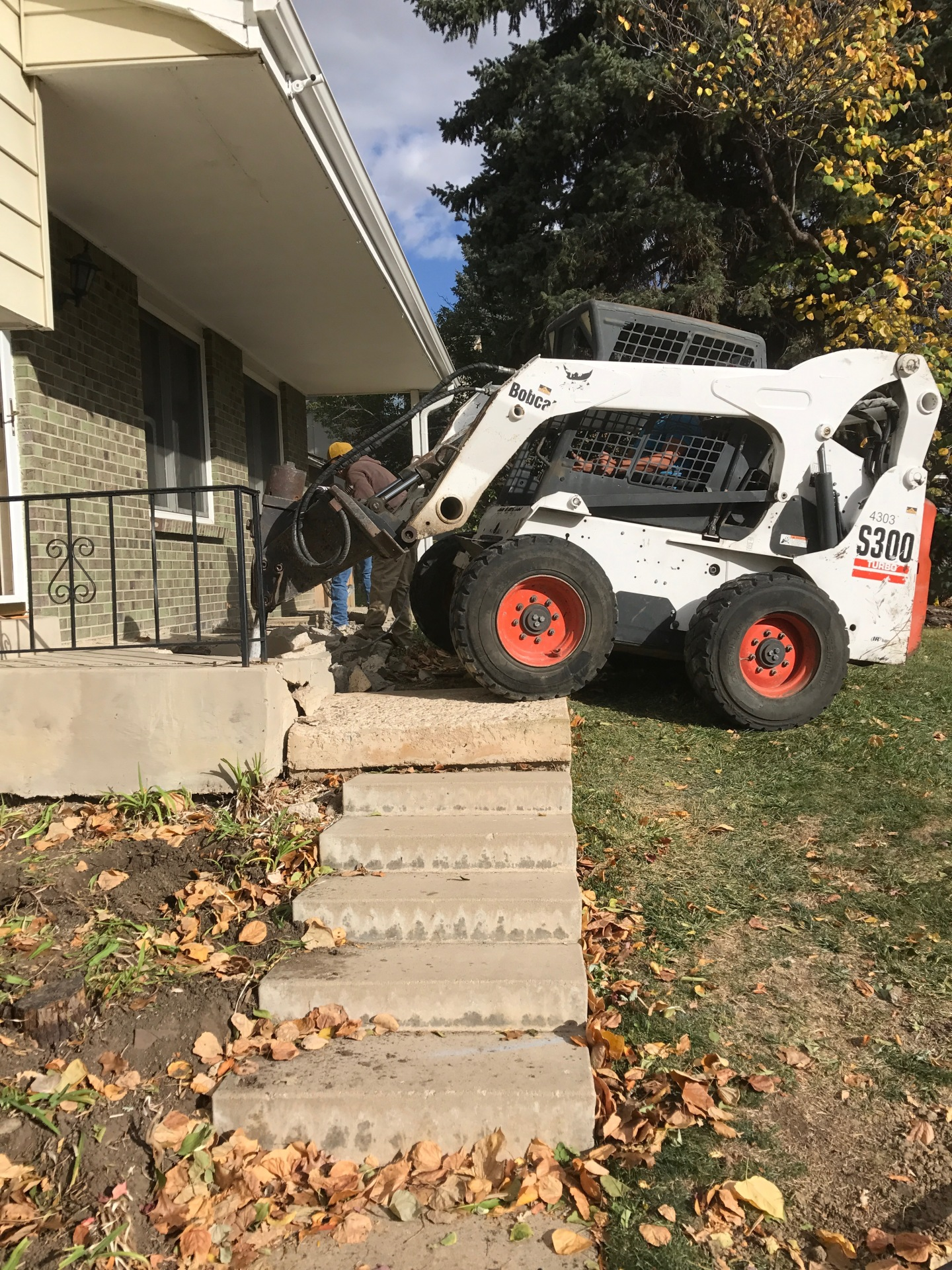 Tearing out old stair case landing