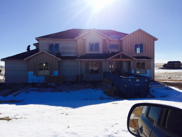 Installing shingles on a new residential construction