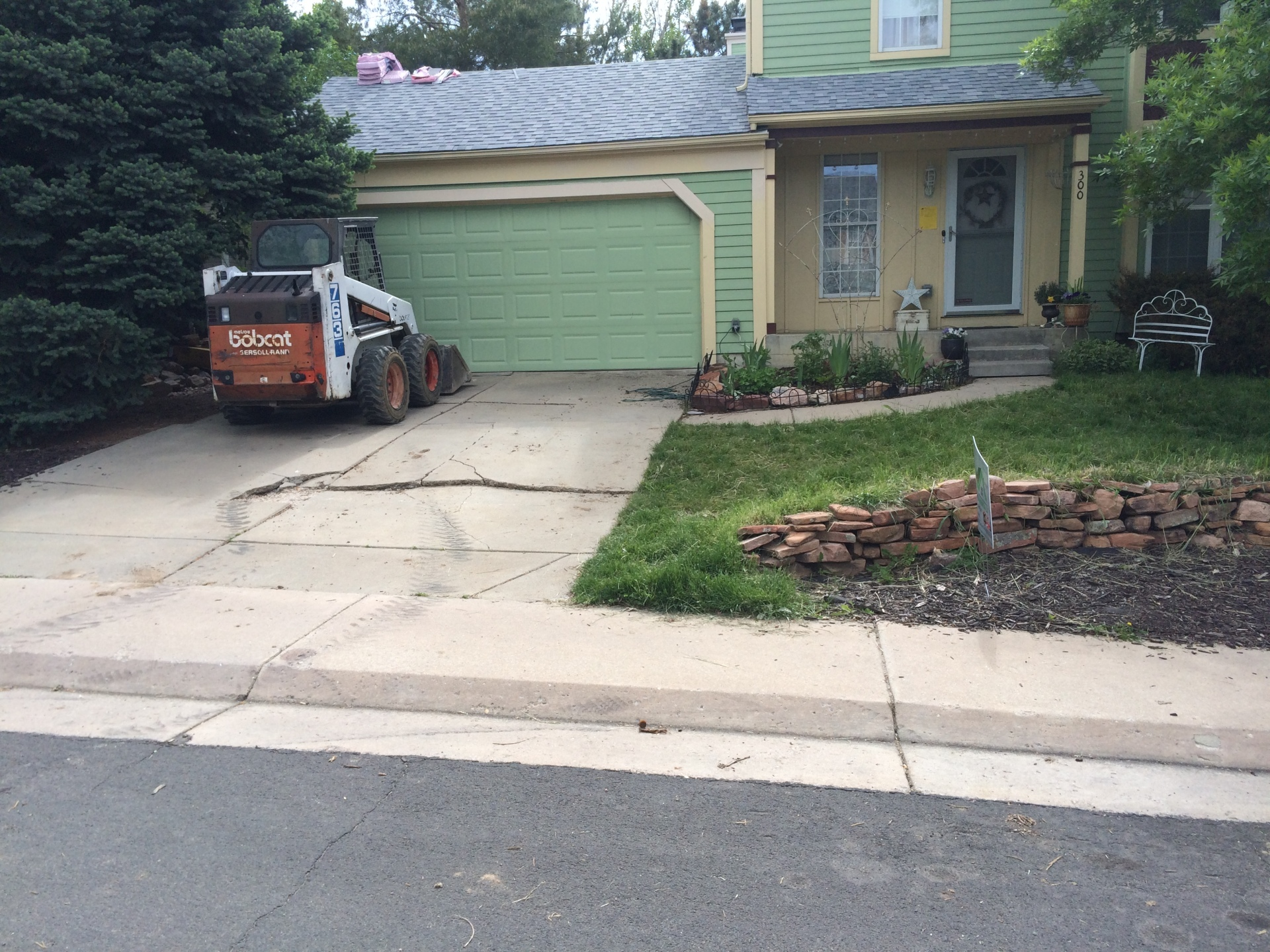 Tearing out old driveway