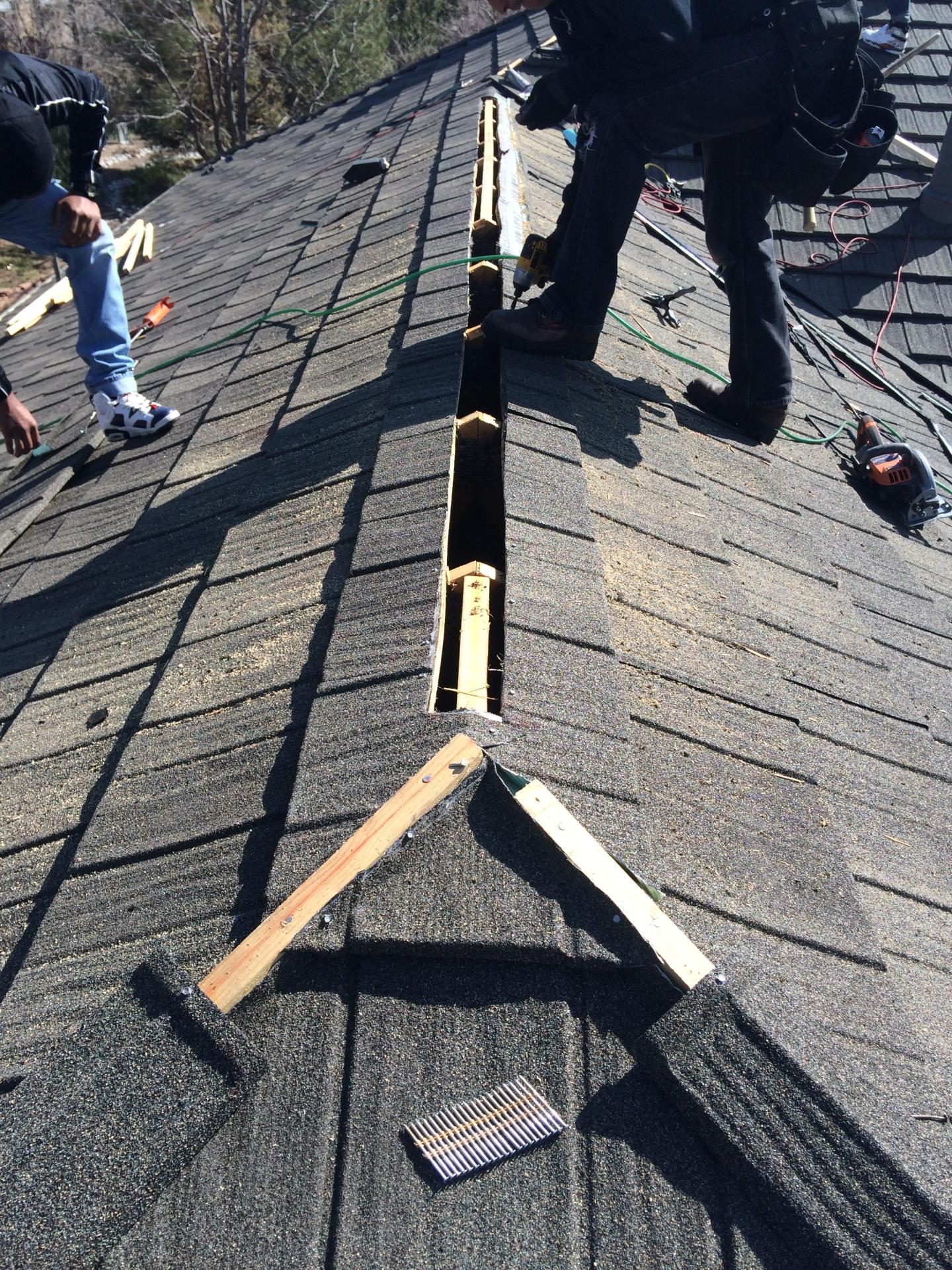 Cutting open a new Decra ridge vent system.