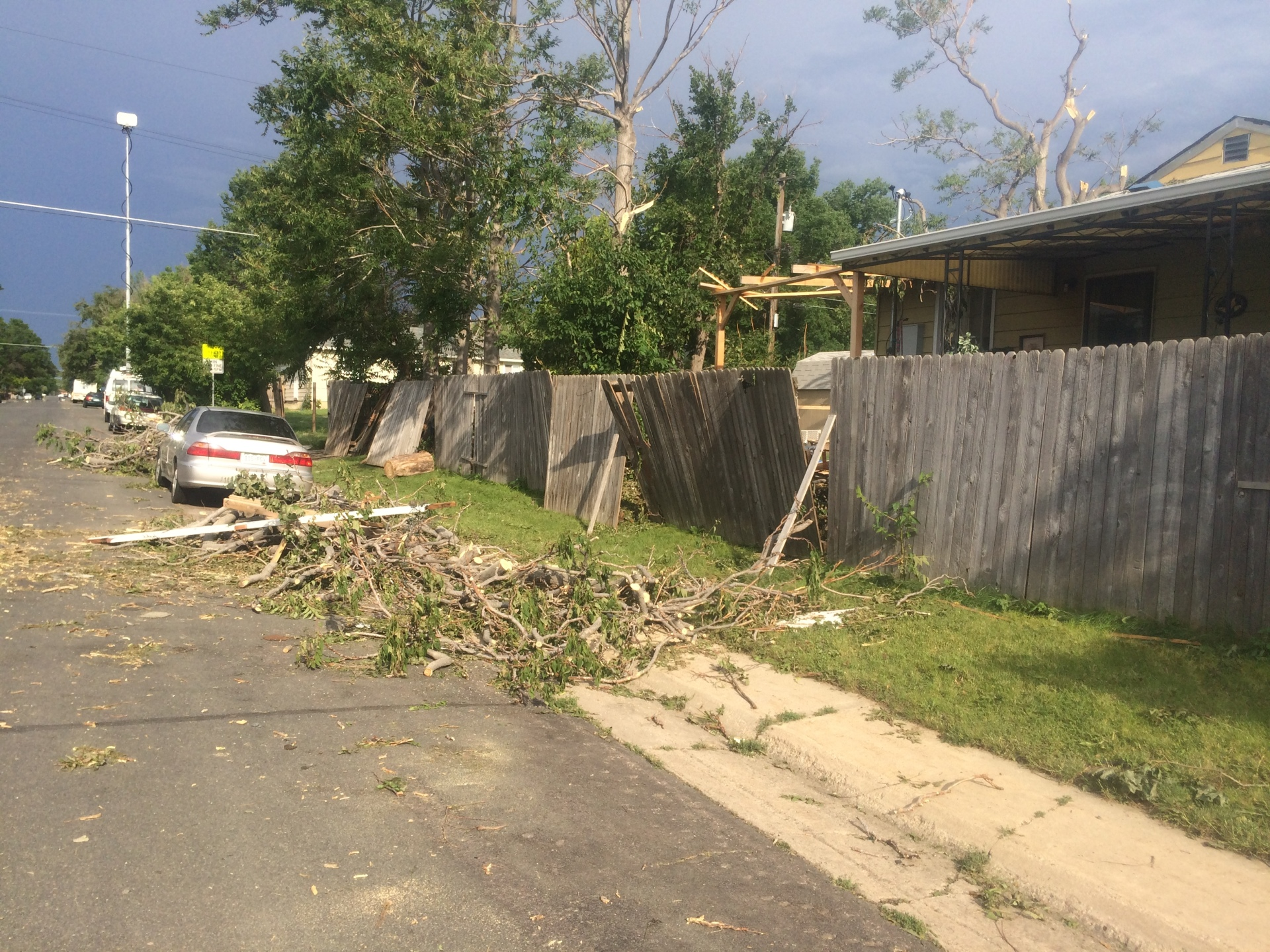 High winds tear out branches, trees and roofs.