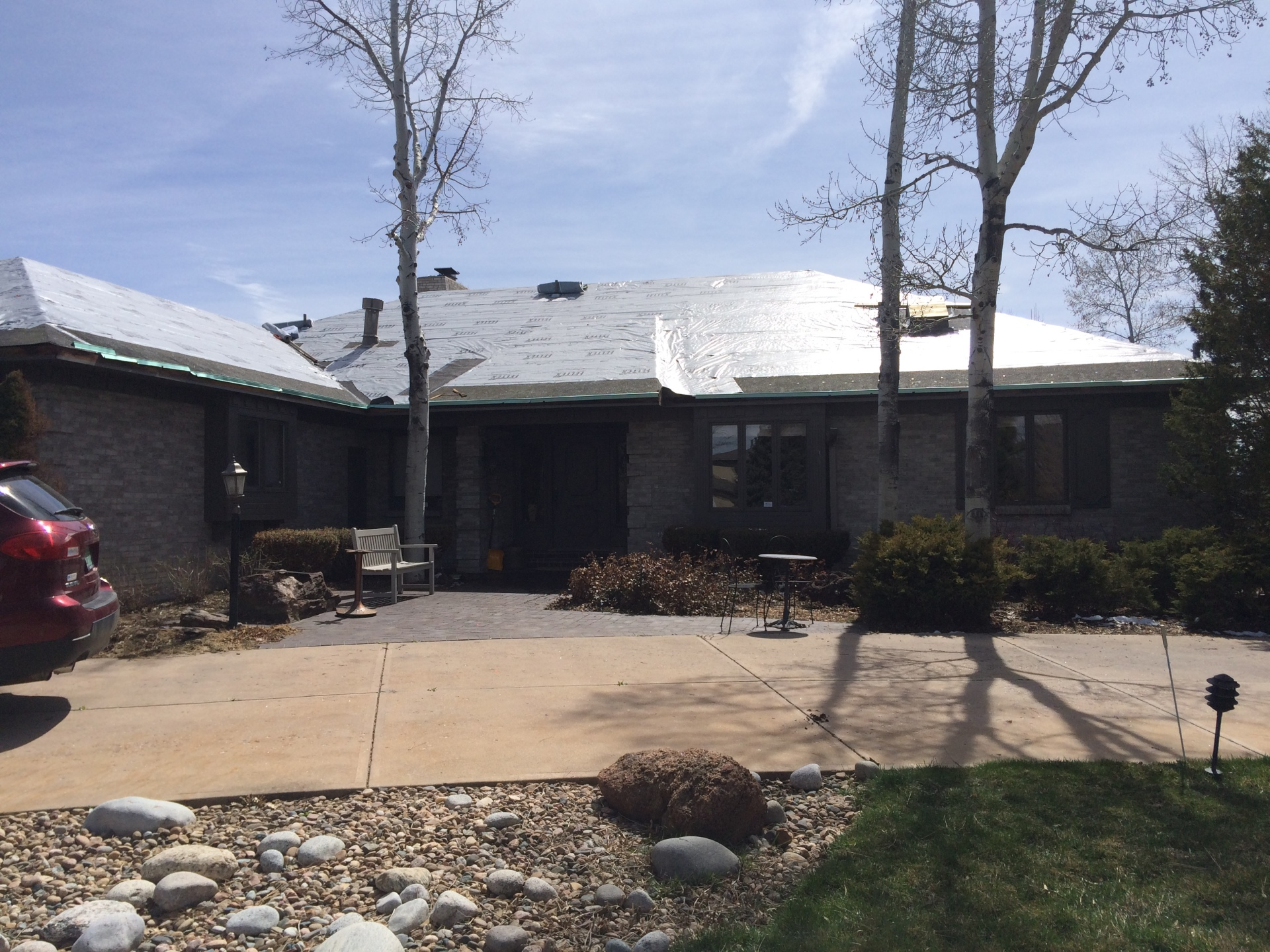 Removed damaged wood shake shingles in the Greenwood Village area  and install Decra product (stone coated steel)