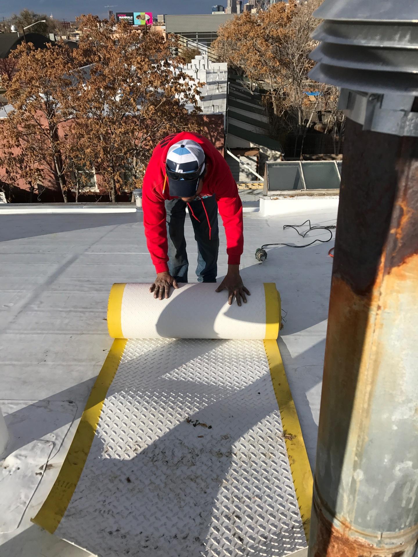 Installing TPO walk pad for slip resistance