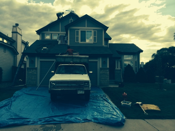 Tearing out old 3-tab shingles and installing new GAF architectural shingles.