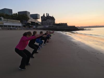 Pilates at sunset on a beach...