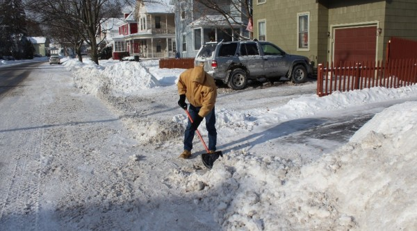 Gloversville resident Andrew Tedesco shovels a driveway on 6th Ave.