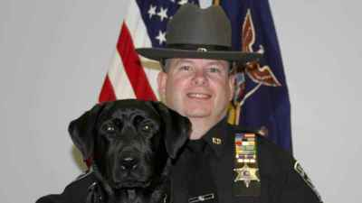 Halli and Rensselaer County Sheriff's Office Deputy Paul Davendonis