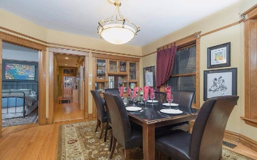 Chicago Guest House Wrigley Suite. formal dining with seating for eight.
