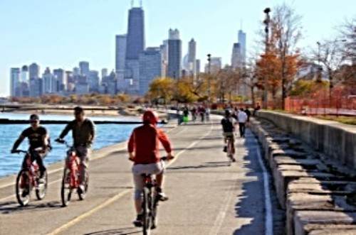 People riding bikes on the lakefront of Chicago